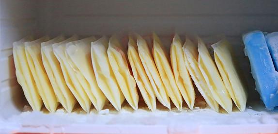 Flat frozen milk bags in freezer